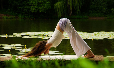 A woman in the yoga position downward facing dog